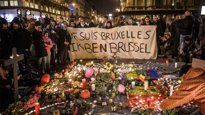 <p>Members of the public have gathered at the Place de la Bourse in Brussels to leave messages and tributes. (AFP)</p>
