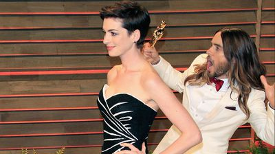 Jared Leto and his Oscar photobomb Anne Hathaway at the Vanity Fair Oscar Party (Getty).