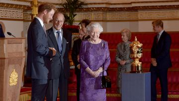 The stars of the Rugby World Cup have been hosted by the Royal Family at Buckingham Palace, a sombre affair after the host nation's dismal showing at home.<br><br>Queen Elizabeth II and keen rugby fan Prince Harry met players and coaches from competing nations ahead of the upcoming quarter-finals. &nbsp;<br><br><strong>Click through to highlights from the meeting.</strong>