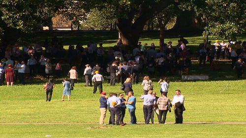 Evacuated staff congregate at The Domain. (9NEWS)