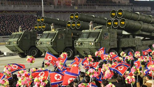 North Korea rolled out developmental ballistic missiles designed to be launched from submarines and other military hardware in a parade that punctuated leader Kim Jong Un's defiant calls to expand his nuclear weapons program.