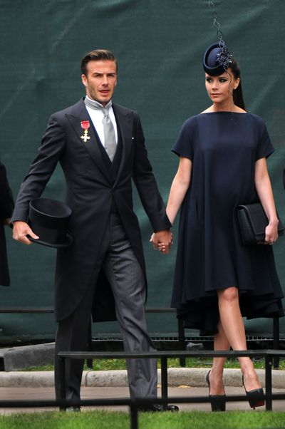 <p>Fashion Royalty</p> <p>The Beckhams were on a style high at the 2011 royal wedding of Prince William to Catherine Middleton.</p> <p>David wore a sleek three-piece-suit by Ralph Lauren and Victoria shone in a navy gown of her own design and matching Philip Treacy hat.</p>