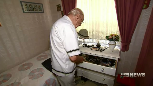 The two men ransacked his drawers, pocketing $400, a watch and valuable stamp collection.