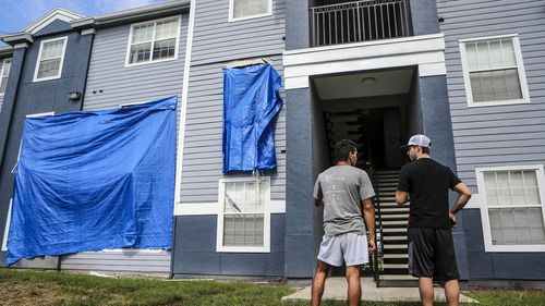 Residents at Westbrook Apartments get a first look at their building where a gunman held four children hostage before taking their life and his own. (AAP)