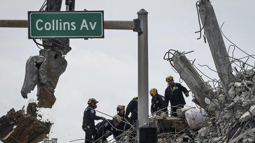 On Monday, lightning forced crews to pause the search for victims of the June 24 collapse in Surfside and a garage area in the rubble-filled with water, officials said.