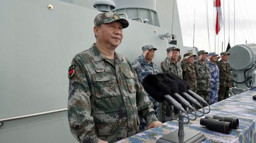 China's leader Xi Jinping inspects a naval parade in the South China Sea. (Photo: Chinese Defence Ministry).