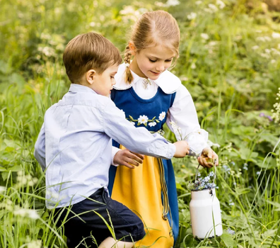 The siblings were photographed collecting wild flowers.