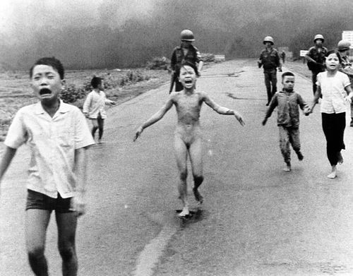 As shown in this Pulitzer Prize winning photograph at the height of the Vietnam War, Kim Phuc, her body burning with napalm, runs naked down a highway in the village of Trang Bang along with her brother Phan The Ngoc on the left after their village was attacked by South Vietnamese bombers who were going after suspected Viet Cong positions in the village. (AAP)