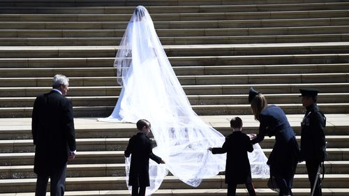 Ms Markle's veil is held in place by Queen Mary's diamond bandeau tiara, lent to her by The Queen. Picture: PA