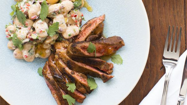 Miguel's butterfly leg of lamb with ras el haout and white bean salad