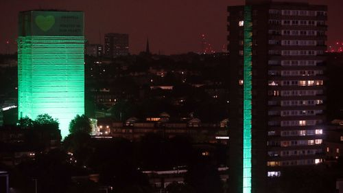 Grenfell Tower was illuminated in green to mark the exact moment the fire broke out in a kitchen. Picture: Getty