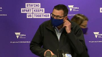 Victoria Premier Daniel Andrews wears face mask.