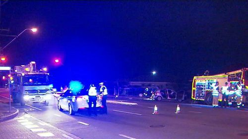 The crash occurred at 10pm yesterday and the woman was trapped with serious injuries. (9NEWS)