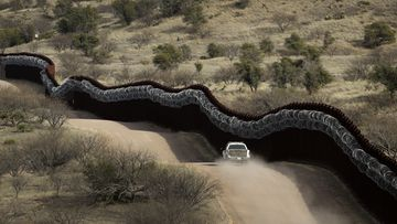 Contagion fears, political row sees US travellers turned back on Mexico border