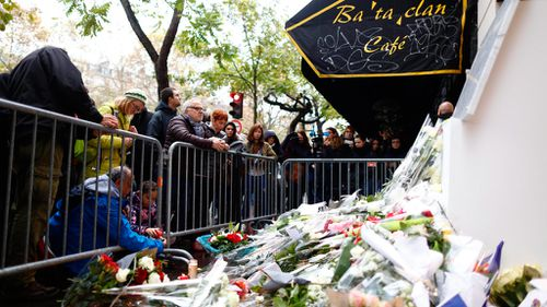 People gather in front of the Bataclan concert hall. (AFP)