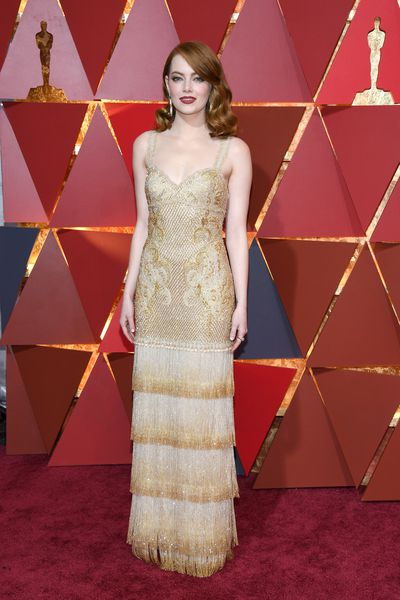 Emma Stone glorious red hair was highlighted by a rusty red lipstick.