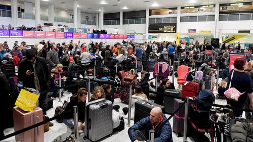 Chaos at Gatwick Airport as people are stranded after drones force its closure for more than 12 hours.