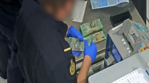 At the same time, ABF currency detection dogs were sweeping the luggage being loaded onto the man's flight, and identified two checked bags both belonging to the man. Between the bags a further $100,200 was seized, marking a total of $145,200.