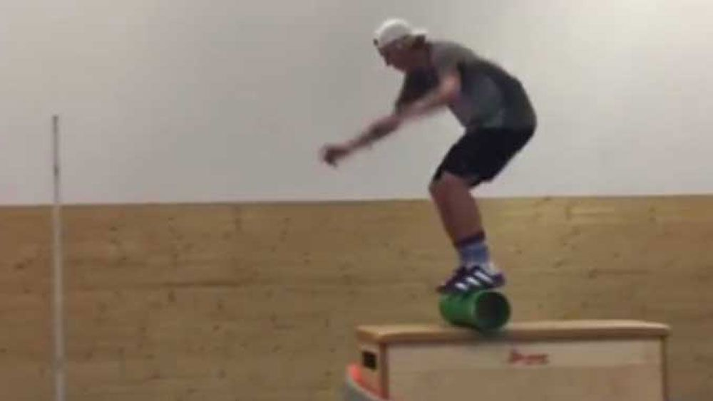Skiier turns on incredible display of balance and strength in the gym