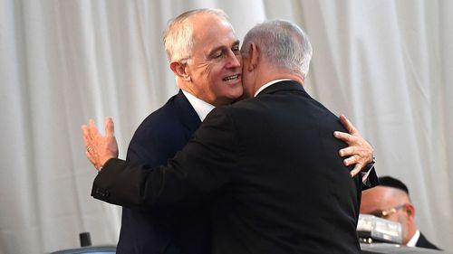 Australian Prime Minister Malcolm Turnbull (left) and Israeli Prime Minister Benjamin Netanyahu embrace during a welcome ceremony