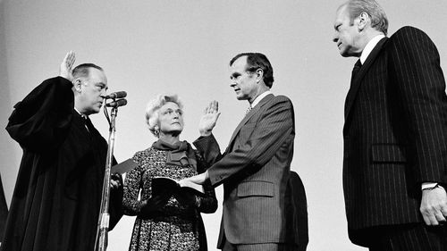 George H.W. Bush is sworn in as director of the Central Intelligence Agency by Supreme Court Associate Justice Potter Stewart, left, as Barbara Bush and President Gerald Ford, right, look on in 1976.