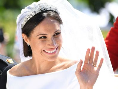 Meghan Markle rides a horse-drawn carriage, after their wedding ceremony at St. George's Chapel in Windsor Castle in Windsor, near London, England, Saturday, May 19, 2018