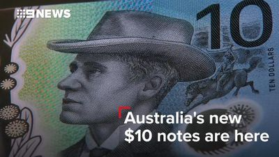 Aussie dollar slips against stronger greenback