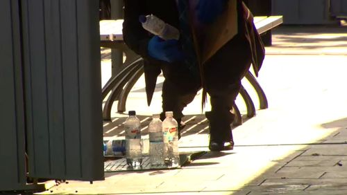 Police hope the bottle would help identify the suspected shooter. (9NEWS)