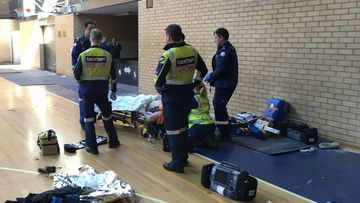 Man falls 10m through roof at Sydney school