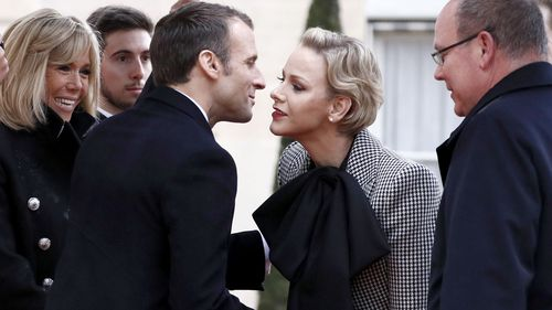 French President Emmanuel Macron and his wife Brigitte welcome Prince Albert II of Monaco and his wife Princess Charlene at the Elysee Palace ahead of the international ceremony for the Centenary of the WWI Armistice in Paris.