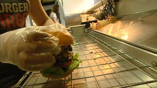 The burger us so hot it has to be cooked using gloves and goggles. (9NEWS)