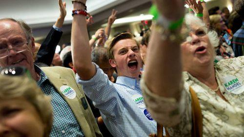 Karen Handel supporters cheer as her victory is announced. (AAP)