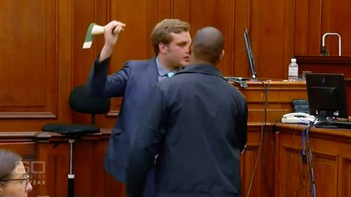 van Breda re-enacts his version of the axe attack in a Cape Town court room. Picture: Supplied