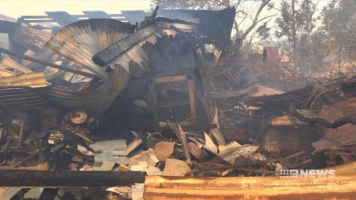 The charred shell of a backyard shed was all that remained after an out of control bushfire tore through a New South Wales property.
