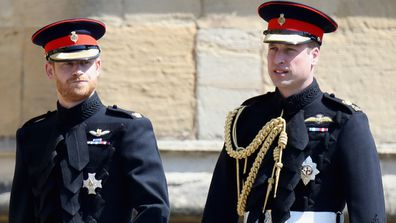 William and Harry in uniform walking