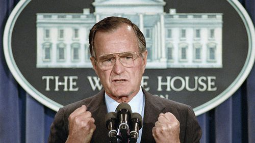 In this June 5, 1989 file photo, US President George H.W. Bush, who has died, holds a news conference at the White House where he condemned the Chinese crackdown on pro-democracy demonstrators in Beijing's Tiananmen Square.