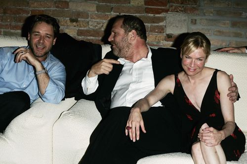 Actor Russell Crowe, producer Harvey Weinstein and actress Renee Zellweger attend the after party for 'Cinderella Man' on the sixth day of the 62nd Venice Film Festival, in 2005.