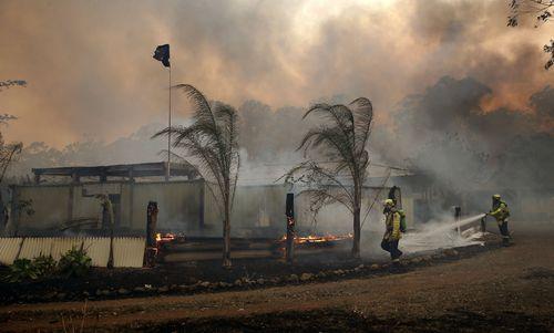 Fire crews save a house in Possum Brush near Taree.