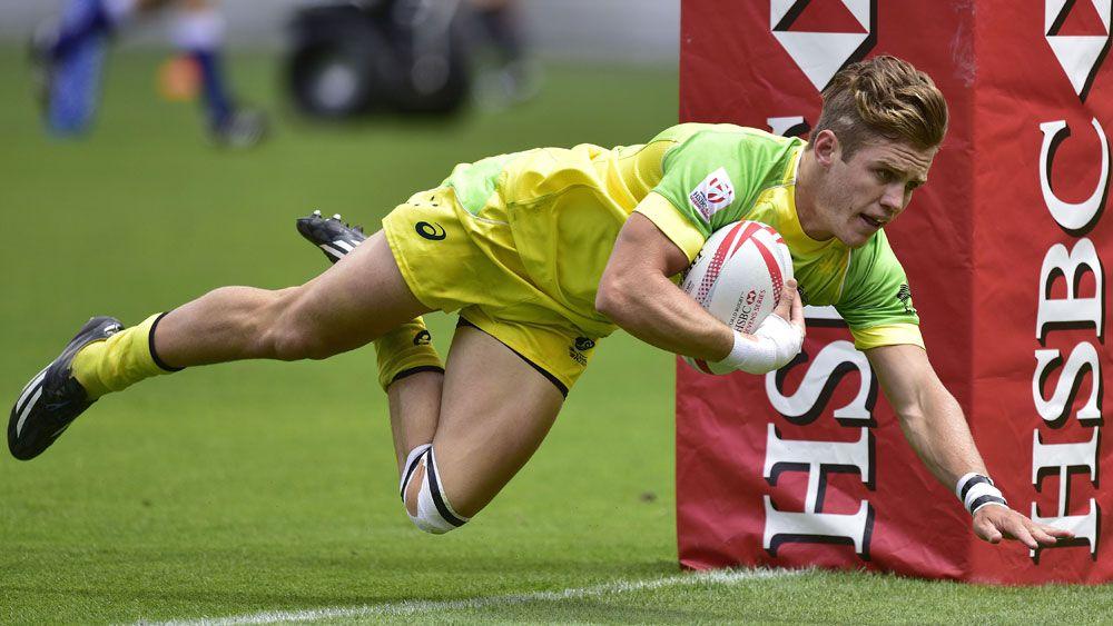 Tom Lucas scores a try for Australia. (AFP)