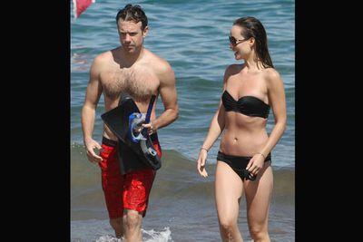 The best accessory to a great bikini is a buff beau. Olivia Wilde cosied up to beau Jason Sudeikis on a romantic Hawaiian holiday. <br/>