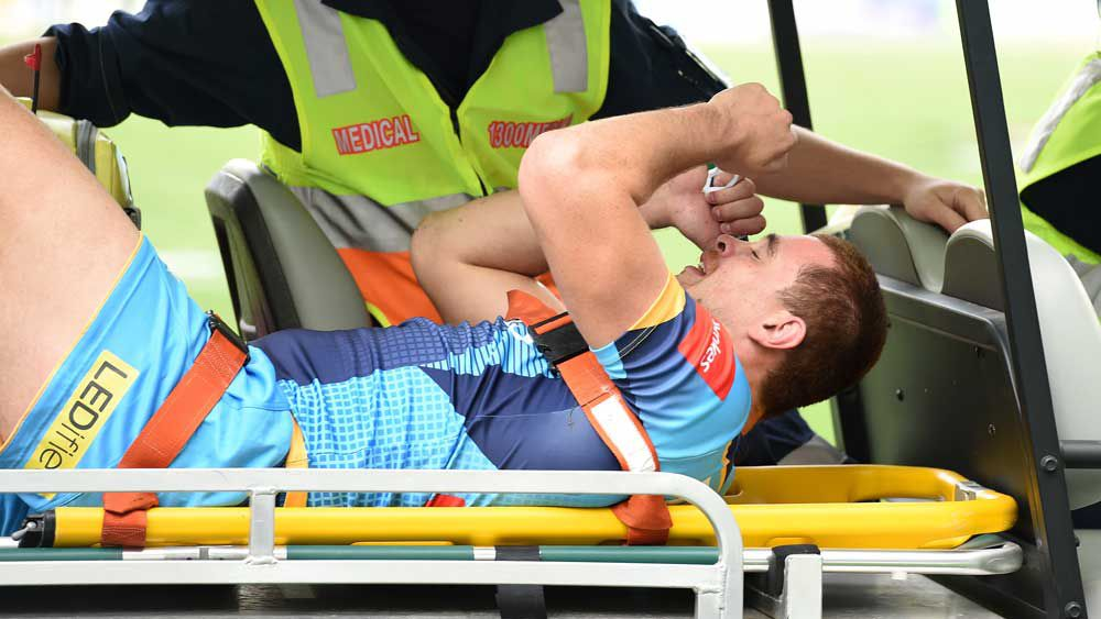Nathan Davis is taken from the field after suffering a horror injury this year. (AAP)