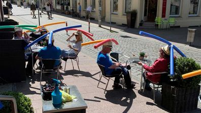 Diners at the Cafe Rothe in Schwerin were asked to wear pool noodle hats for social distancing.