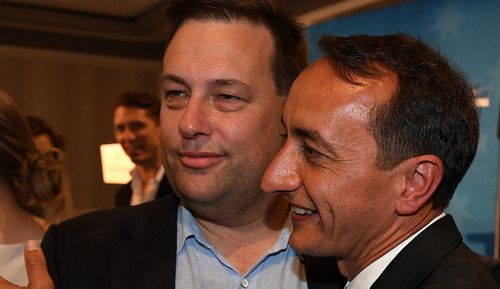 Liberal candidate Dave Sharma puts on a brave face with Liberal MP Jason Falinski.