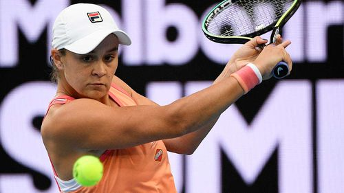 Australia's Ash Barty makes a backhand return to Romania's Ana Bogdan.