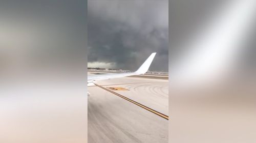 A tornado touched down at a US airport this week. (Storyful/Philip Hersh)