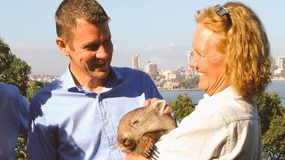 Everyone loves a cute photo opportunity with an animal. Premier Mike Baird committed $115m to Taronga Zoo during the campaign.<br>But this photo call was just too good an opportunity to pass up. (9NEWS)