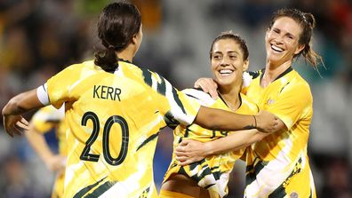 Katrina Gorry of the Matildas celebrates with her team mates Sam Kerr and Elise Kellond-Knight