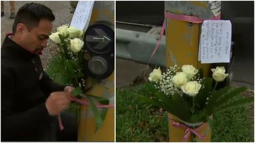 A local man is pictured leaving flowers for the teenage girl. (9NEWS)