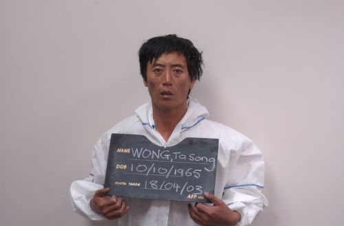 A man known as Ta Sa Wong in custody in 2003.