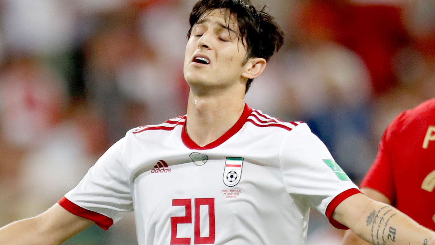 Sardar Azmoun reacts during the group B match between Iran and Portugal at the World Cup. (AAP)
